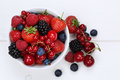 Berry fruits mix in bowl with strawberries, blueberries and cher Royalty Free Stock Photo