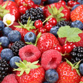 Berry fruits in summer with strawberries, blueberries and raspbe Royalty Free Stock Photo