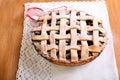 Berry lattice pie with icing sugar over Stock Photos