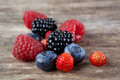 Berry mix on wood Royalty Free Stock Photo