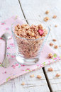 Berry muesli on rusted wooden table glass full of with berries background Royalty Free Stock Photo