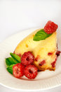 Berry pie a piece is decorated with fresh raspberry and mint leaves Royalty Free Stock Images