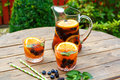 Berry sangria - summer cocktail, decorated with berries, orange Royalty Free Stock Photo