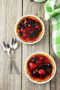 Berry tarts fresh on grey wooden background Royalty Free Stock Photo
