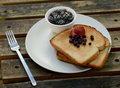 Berry toast breakfast on wood Stock Image