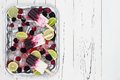 Berry vanilla ice pops - popsicles - in a vintage silver ice tray over old rustic wooden background. Royalty Free Stock Photo
