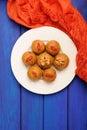 Besan laddu, vegan iIdian sweets with wallnuts and goji berries Royalty Free Stock Photo