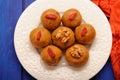 Besan laddu, vegan Indian sweets with wallnuts and goji berries Royalty Free Stock Photo