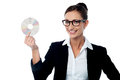 Bespectacled business woman holding cd smiling corporate lady Royalty Free Stock Photos