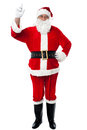 Bespectacled Santa pointing upwards Royalty Free Stock Photos