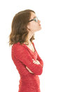 Bespectacled teenage girl in red dress pouting a wearing glasses a profile with arms crossed Stock Photos