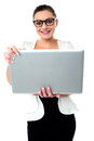 Bespectacled woman holding a laptop cheerful wearing spectacles posing with Stock Photos