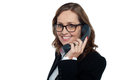 Bespectacled woman talking over the phone Royalty Free Stock Photos