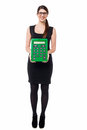 Bespectacled young female displaying calculator employee big green Royalty Free Stock Photos