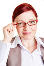 Best ager business woman smiling and touching spectacles of her glasses Royalty Free Stock Photos