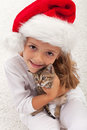 The best christmas present ever happy little girl with her new kitten Stock Photography