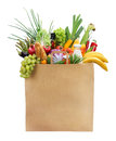 Best foods in a package for customer studio photography of brown grocery bag with fruits vegetables bread bottled beverages Royalty Free Stock Photography