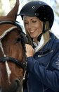 Best friends closeup outdoor portrait of female rider and horse embracing Stock Image