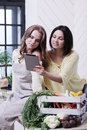 Best friends cooking two girls in the kitchen Stock Photos