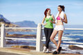 Best friends enjoying the outdoors two fit health young athletic women taking a break from exercise Stock Photos