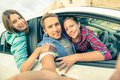 Best friends having fun together at car trip on the road Royalty Free Stock Photo