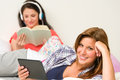 Best friends resting in their room and reading Royalty Free Stock Photo
