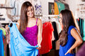 Best friends shopping together pretty female some clothes in a store Royalty Free Stock Image