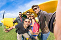 Best friends taking selfie at aeroclub with ultra light airplane happy friendship fun concept young people and new technology Royalty Free Stock Photography