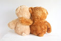 Best friends two teddy bears with arms around each other Stock Photo