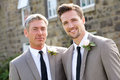 Best man and groom at wedding smiling to camera Royalty Free Stock Photo