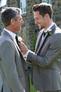 Best man and groom at wedding smiling to each other Stock Photography