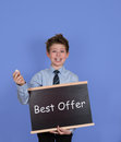 Best offer concept. Boy with Blackboard Slate on Blue Background. Royalty Free Stock Photo