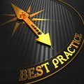Best practice business background golden compass needle on a black field pointing to the word d render Royalty Free Stock Photos