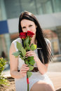 Best present woman with roses young beautiful red outdoorf lifestyle portrait Royalty Free Stock Images