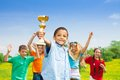 Best team ever portrait of black happy smiling little boy holding prize cup with his on background Stock Images