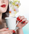 Best tradition tea beautiful girl with a cup of green buds of orchids Stock Photo