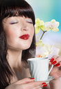 Best tradition tea beautiful girl with a cup of green buds of orchids Royalty Free Stock Photography