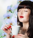 The best traditions of asian tea beautiful girl with a cup aromatic beverage Stock Photography