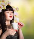 The best traditions of asian tea japanese beautiful girl with a cup aromatic beverage Royalty Free Stock Photos