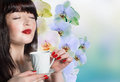 The best traditions of asian tea japanese beautiful girl with a cup aromatic beverage Stock Photo