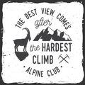 Vintage typography design with ice axe, rock climbing Goat and mountain silhouette. Royalty Free Stock Photo