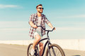 Best way to start a day happy young man in eyewear riding bicycle and smiling Stock Photography