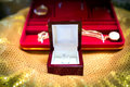 Betrothal  wedding ring and gold necklace. - Selective focus Royalty Free Stock Photo