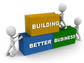 Better business building concept words put in place by little men Stock Photo