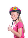 Better safe than sorry portrait of a caucasian little girl showing her thumb up because she is wearing a helmet for riding her Royalty Free Stock Image