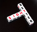 Better sight text and inscribed in uppercase letters on small cubes and presented crossword style with common letter t maybe Stock Photo