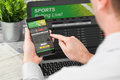 Betting bet sport phone gamble laptop concept Royalty Free Stock Photo