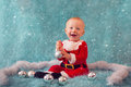 Beautiful smiling little boy in santa costume Royalty Free Stock Photo