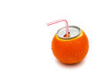 Beverage can's top and a straw on a fresh orange Stock Photography