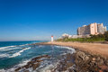 Beverly hills hotel beach lighthouse beach view of hotels apartments and with public walkway promenade and beaches at umhlanga Royalty Free Stock Photography